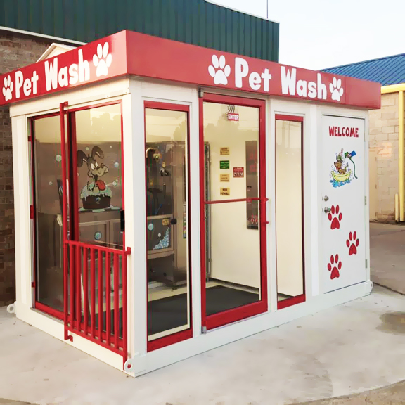 Natchitoches' pet wash housing unit with red trim.